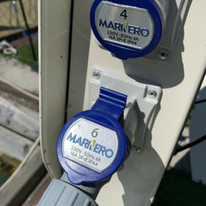 Custom metal badges on Marinero Smart Pedestal power outlet covers